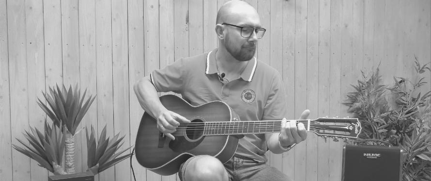 Få god lyd ut av din akustiske gitar